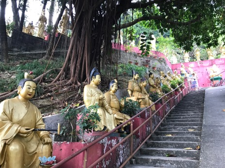The many buddhas lined up the stairs.